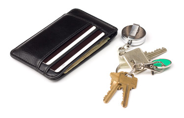 black leather wallet and bunch of keys over white