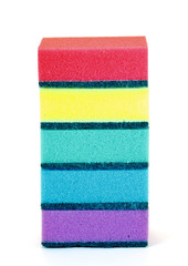 A stack of red, blue, yellow, violet and green sponges isolated