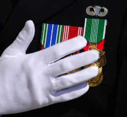 White glove on military medals