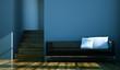 Wohndesign - schwarzes Sofa vor blauer Wand