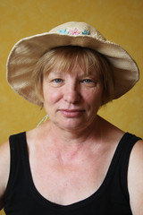 senior woman in the straw hat