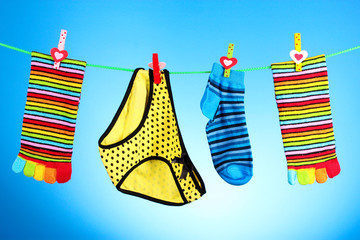 bright socks and shorts on a blue background