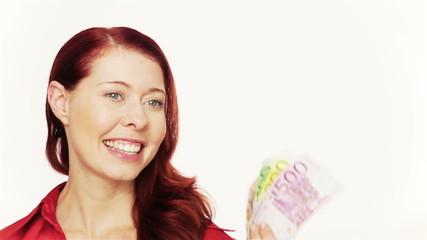 Redhead woman waving Euro bills