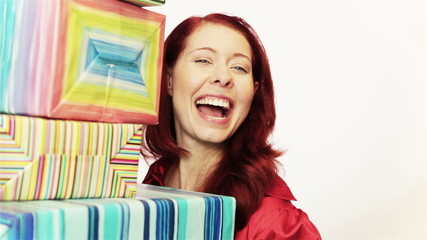 Redhead woman with christmas presents