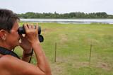 Senior woman birdwatching 1 poster