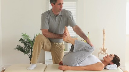 Chiropractor and patient doing exercises
