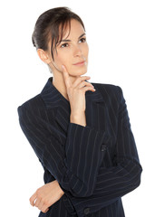 Young pensive business woman looking upwards