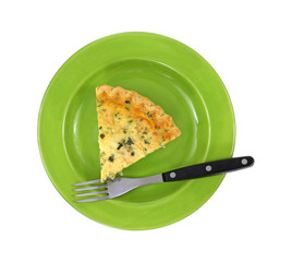 Spinach Quiche On Green Plate With Fork