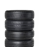 Different types of snow tires on white background