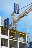Ñoncrete formwork under crane on construction site poster