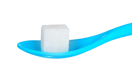 lump sugar in blue plastic spoon isolated on white