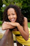 Beautiful african american woman sitting on a bench