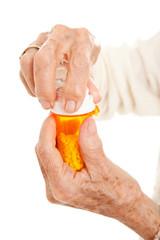 Senior Hands on Prescription Bottle