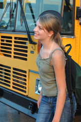 Teenage school girl meeting school bus.