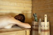 girl lying  in  sauna