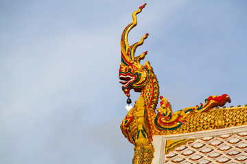 statue king of nagas in front of buddhist temple