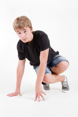 Teen b-boy posing on white background
