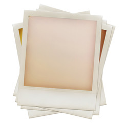 A pile of grungy blank instant film frames
