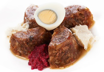 Jellied meat with boiled egg and horseradish