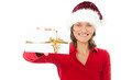 woman with christmas hat holding present on white