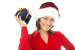 woman with christmas hat holding a present on white