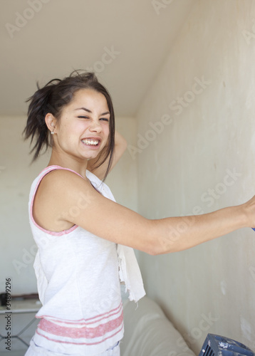 girl painting apartment