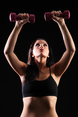 Strong beautiful fitness girl weight lifting