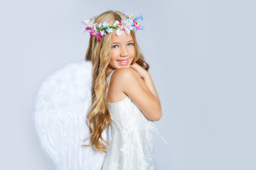 Angel girl children sweet expression and white wings