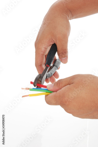 Hand using wire cutter