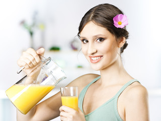 Young and beautiful woman having breakfast in the morning