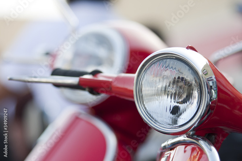 Old scooter headlight vs new on the background
