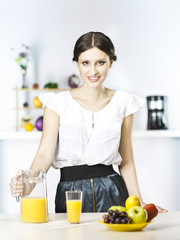 woman drinking fruit juice in the kitchen