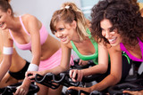 Females cycling in spinning class in gym