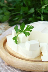 feta cheese on wooden cutting board
