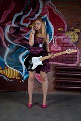 Blonde girl with electric guitar
