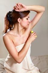 woman applying antiperspirant