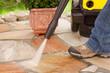 Leinwandbild Motiv Naturstein Terrasse mit Hochdruckreiniger reinigen