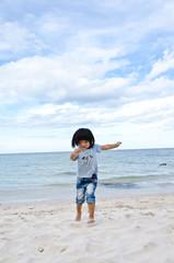 little asian girl running on the beach