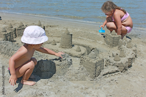 kids with sand castle