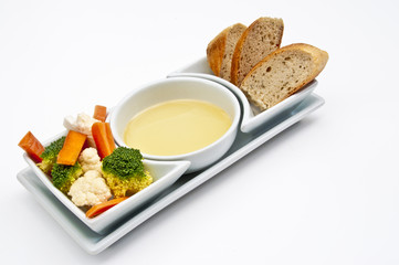 White shaped dishes with vegetables, bread and olive oil