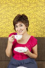 coffee time, female model drinking tea/coffee break, happy.