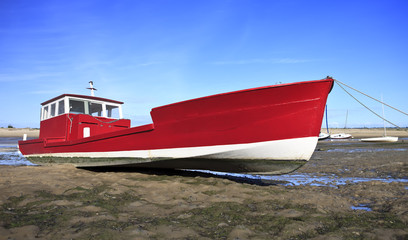 Red boat at low tide in Lege Cap Ferret, France