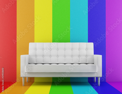 white couch in front of rainbow multicolored wall