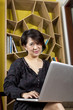 laptop online, female model using laptop.