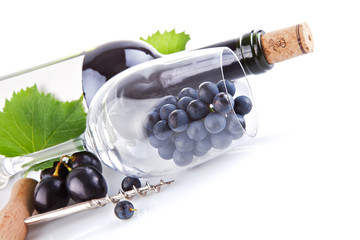 wine bottle with glass and grapes isolated