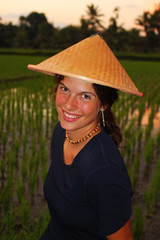 Young woman with traditional conical asian hat