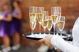 Waiter serving champagne at festive event poster