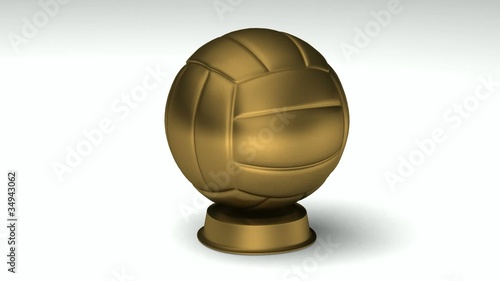 Close-up on a turning golden volleyball trophy