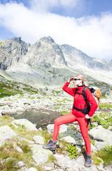 woman backpacker at Five Spis Tarns, Vysoke Tatry (High Tatras),