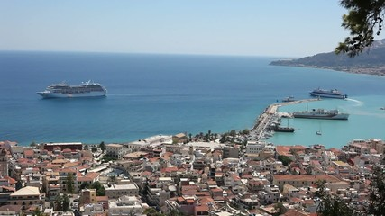 Ship leaving Zakinthos Port in Greece and passing liner